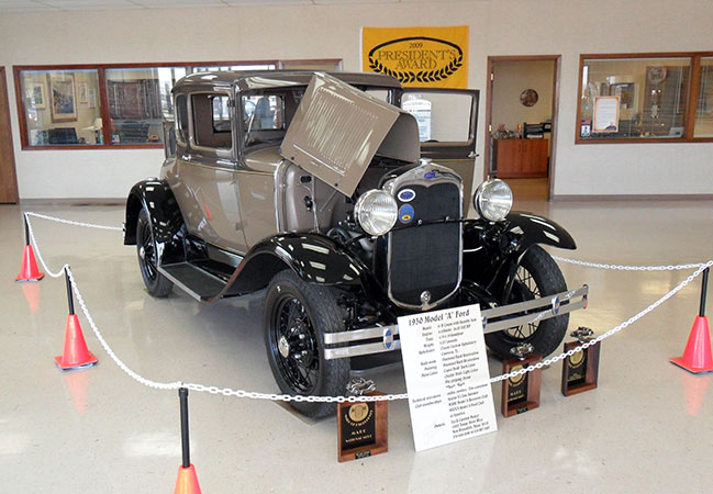ford model a coupe on display inside a san antonio ford dealership. Cars Review. Best American Auto & Cars Review
